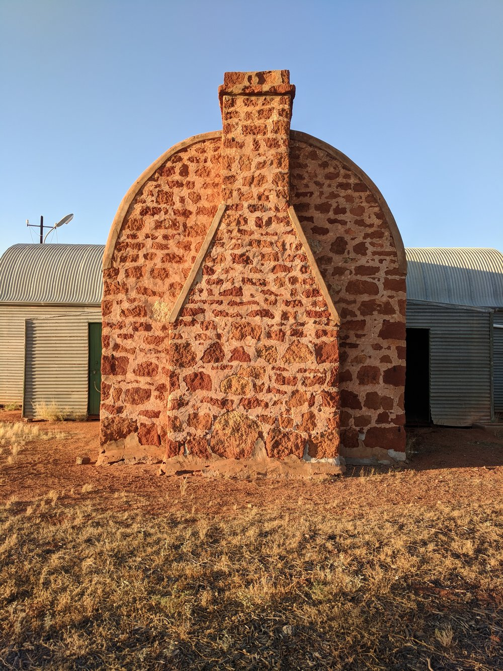 Shearers mess fireplace, local stone and curved corrugations