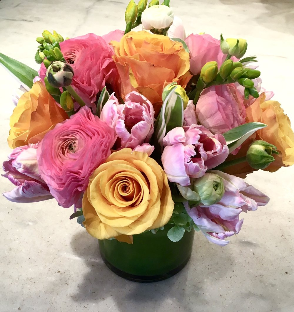 Bright Spring ranunculus, parrot tulips, freesia and Tycoon roses.jpg