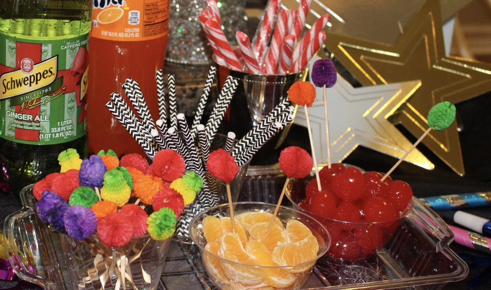 Include some festive toothpicks, peppermint sticks and fresh fruit for garnishes on a plastic tray. I cut colorful paper straws to fit the smaller cups for the kids.