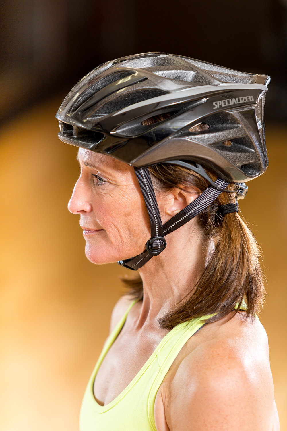 Robin demonstrates a  properly fitting helmet which covers your forehead, and the straps should be snug.
