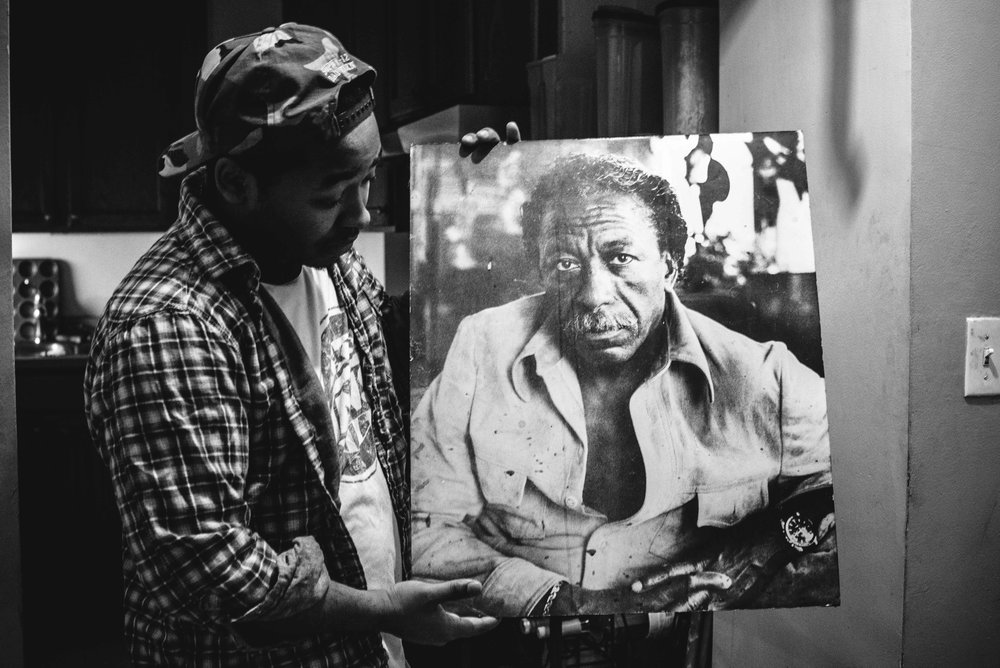 Kenneth Fontenelle with a portrait of Gordon Parks, given to his father by the photographer. (c) Harriet Dedman 2016