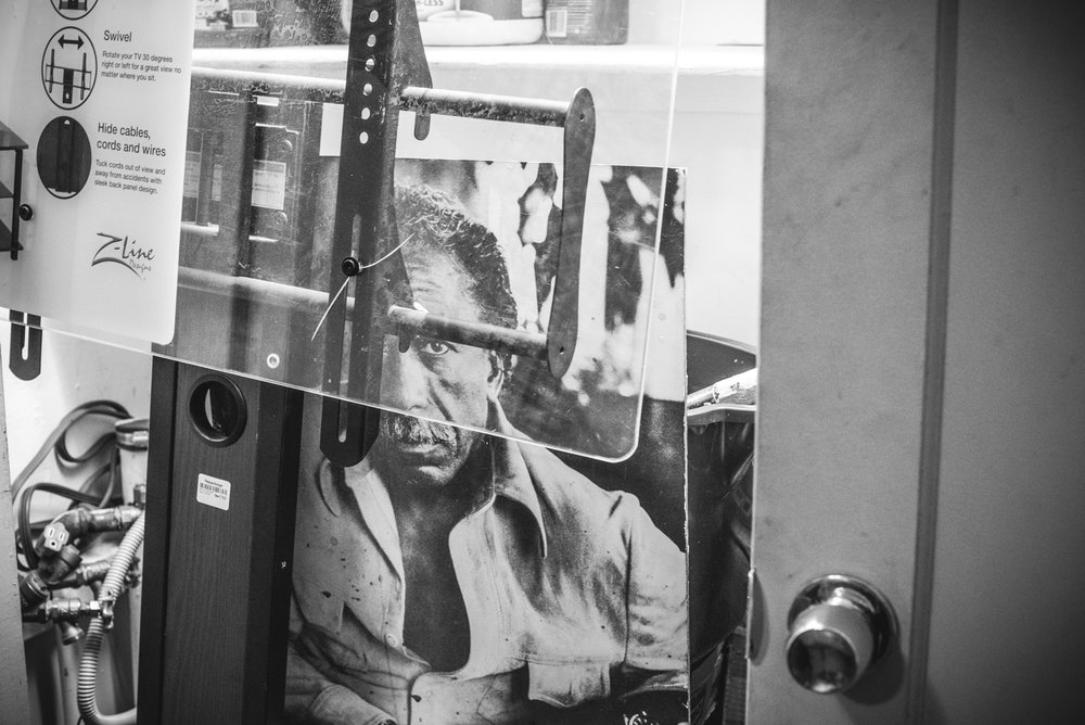The portrait of Gordon Parks, given to Kenneth's father, Little Richard, is stored in his current apartment. (c) Harriet Dedman 2016