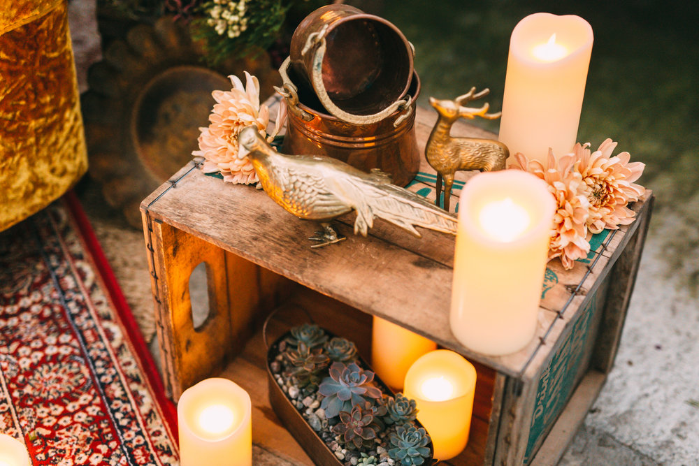 amanda cowley events niagara wedding planner free spirit styling bohemian style greenhouse peackcock chair eclectic style florals pillar candles