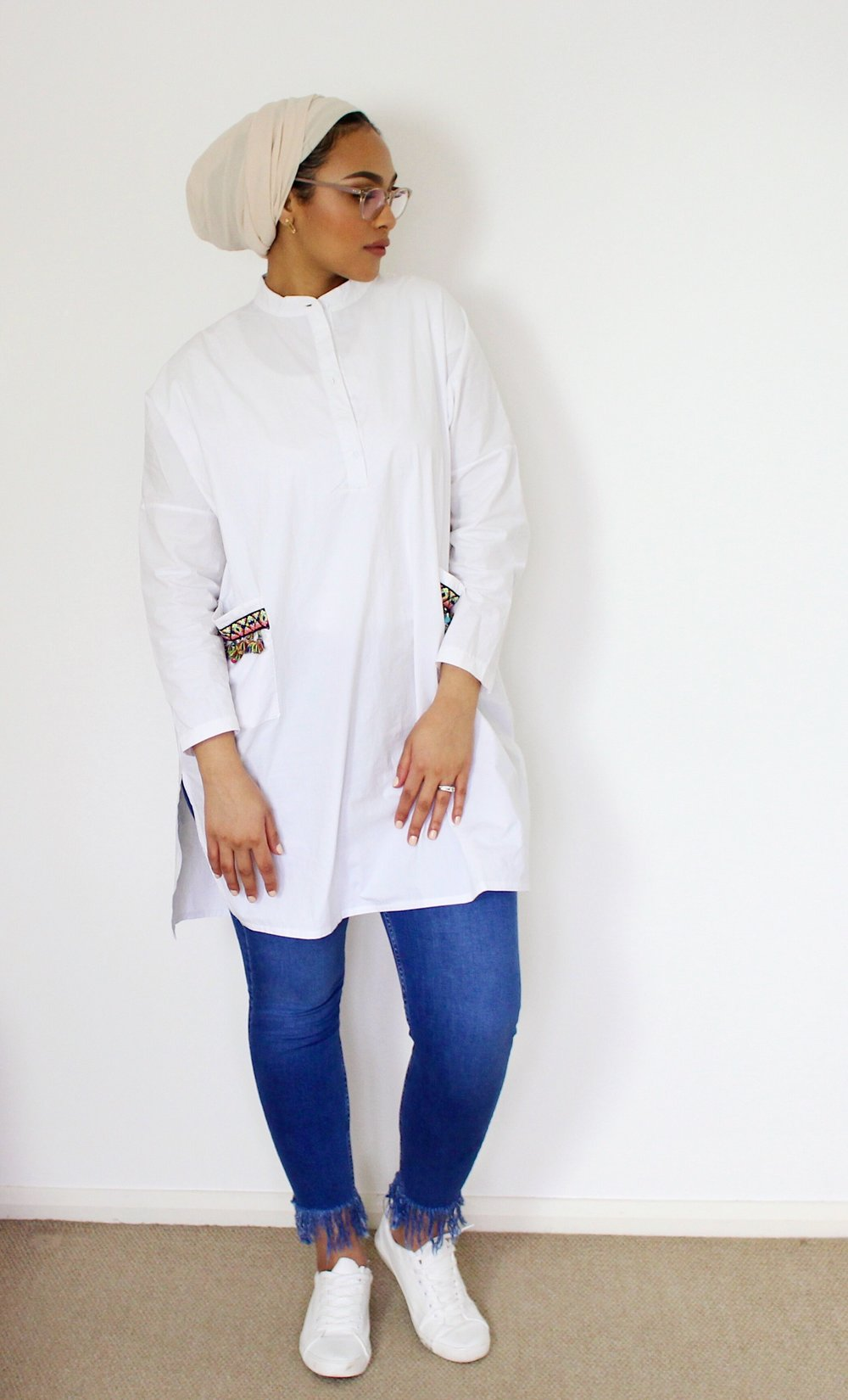I LOVE the look of oversized shirts with some white sneakers. Top it off with some denim and you really can't go wrong! How cute are these Frayed Jeans! I think its super cute with the Pocket Pom Pom Detailing on the shirt! Also, Keeping this outfit looking fresh with our ivory scarf LANAI!