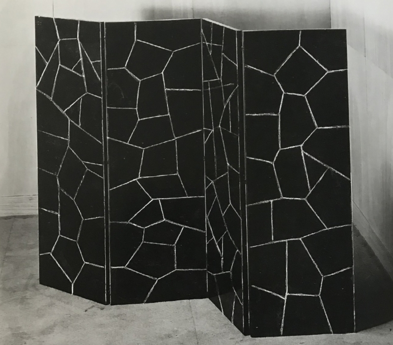 Four-paneled screen covered in black stone in an irregular pattern, circa 1930.