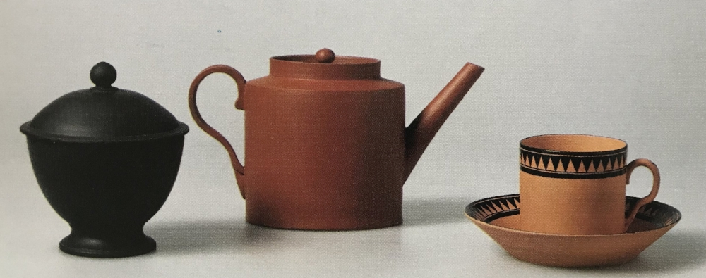 Group of Wedgwood Dry Body Teawares. From left: black basalt sugar bowl, 1874; red stoneware teapot 1931, stoneware tea bowl and saucer, 1947