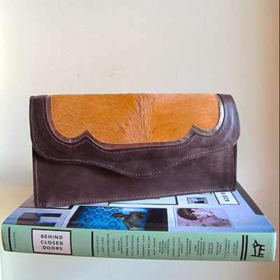 GWENNIE  _____   Clutch bag with a back panel handle Detailed front panel in mixed materials. Inside coin zip purse. Magnetic clasp  Chocolate brown leather, bronze metallic trim & tan ponyhair detail  W: 230mm x H: 120mm x D: 40mm  From £220  Choose your colour and materials – please get in touch