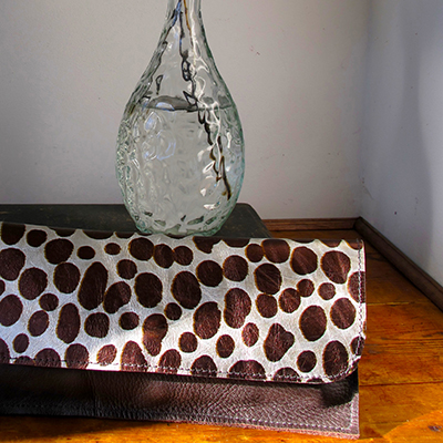 MINNIE  _____  Small purse/envelope clutch  One or mixed materials  Brown leather main body with metallic leopard print front panel. Magnetic clasp  W: 220mm x H: 110mm  From £45  Choose your colour and materials – please get in touch