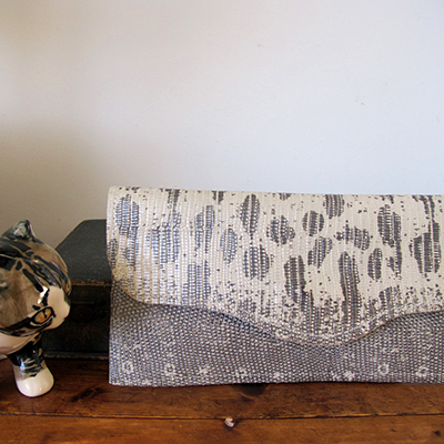 ROSEMARY  _____     Envelope clutch bag in one material  Snake pattern embossed silver and grey leather, magnetic clasp  W: 255mm x H: 125mm  From £55  Choose your colour and material – please get in touch