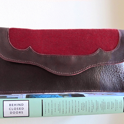 VICTORIA  _____     Front panel detail envelope clutch in mixed materials  Red leather with a tonal red felted wool panel  W: 255mm x H: 125mm  From £65  Choose your colour and material – please get in touc