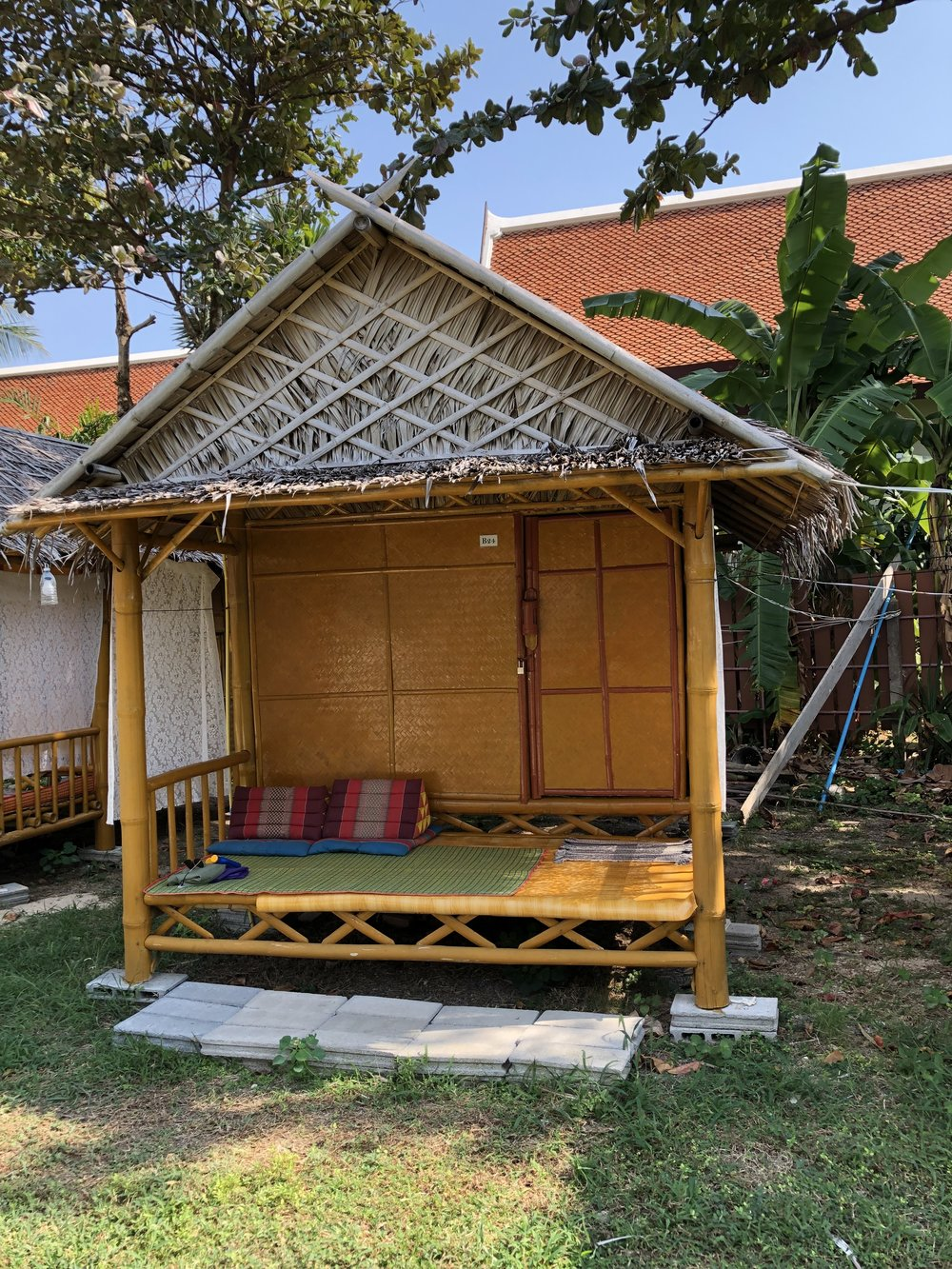 """AJ's - We stayed at the cutest beach """"resort"""" called AJ's- that we would highly recommend staying at if you are ever on the island. It had simple bamboo huts with a mattress, a mosquito net and a fan, nothing fancy but it was perfect for what we needed."""