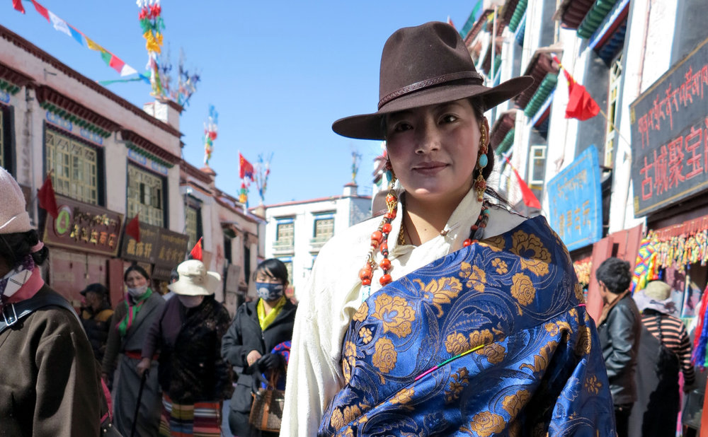 A Tibetan woman from Kham walks the Barkhor in Lhasa during Losar.