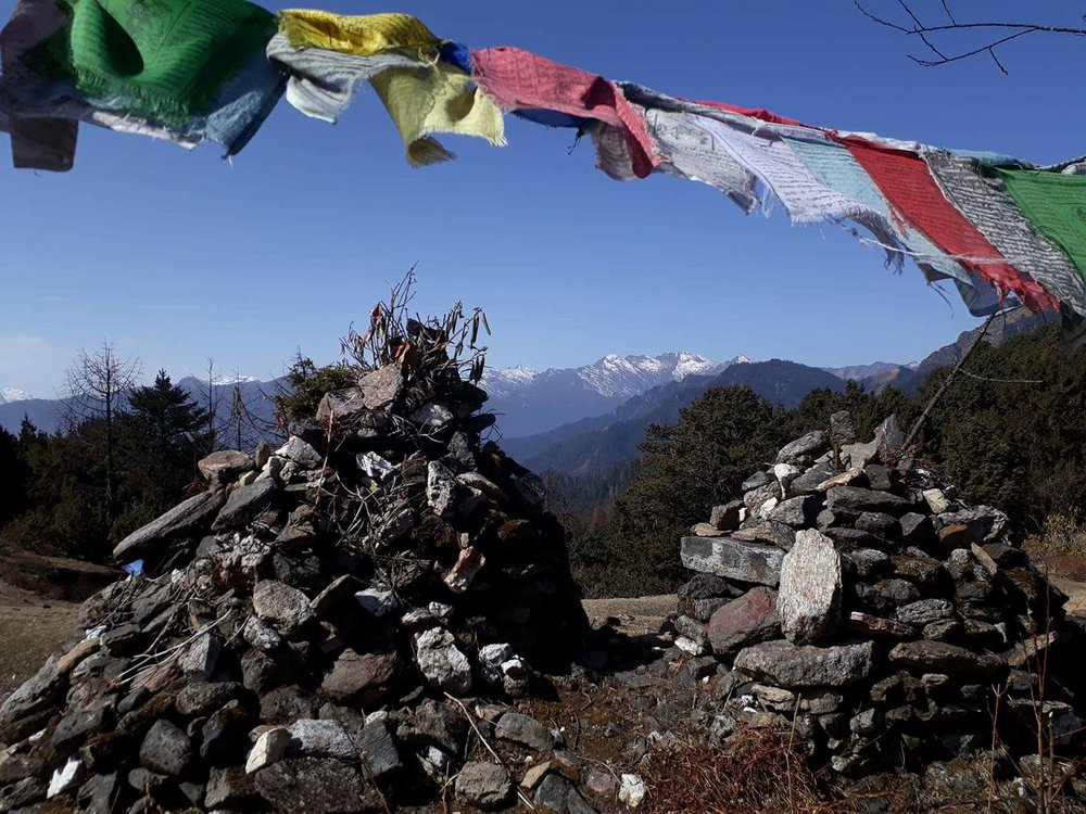 Cairns and prayer flags at the Sagala Pass