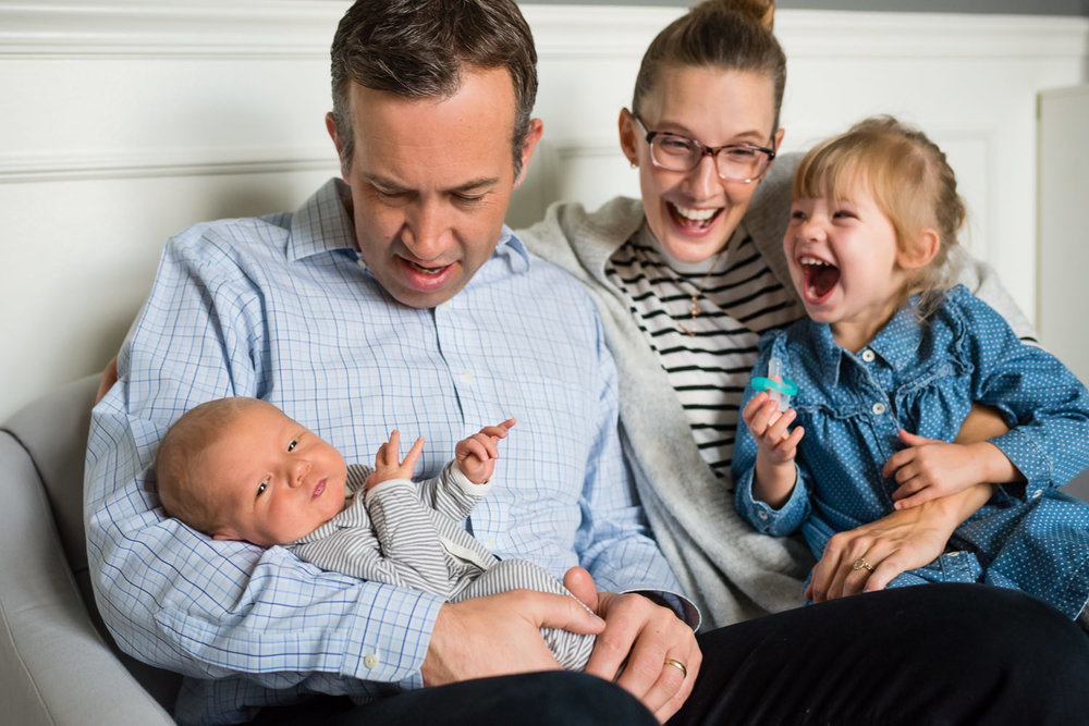 famliy with newborn baby and little girl laughing_.jpg