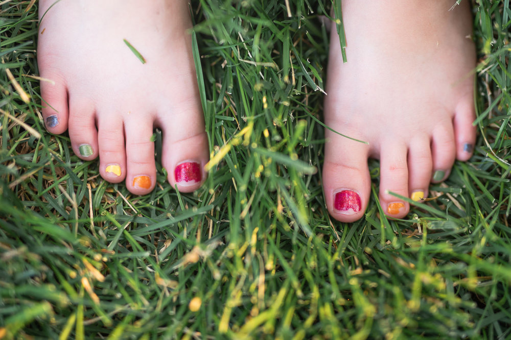 chipped rainbow pedicure little girl in Lincoln Nebraska.jpg