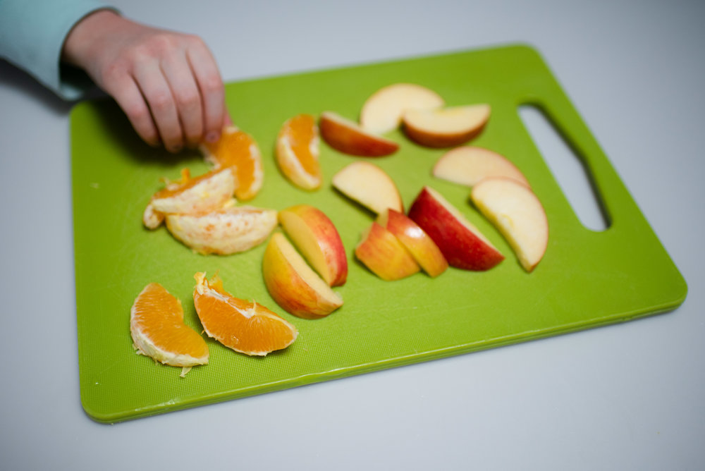 apple and orange sliced on cutting board.jpg