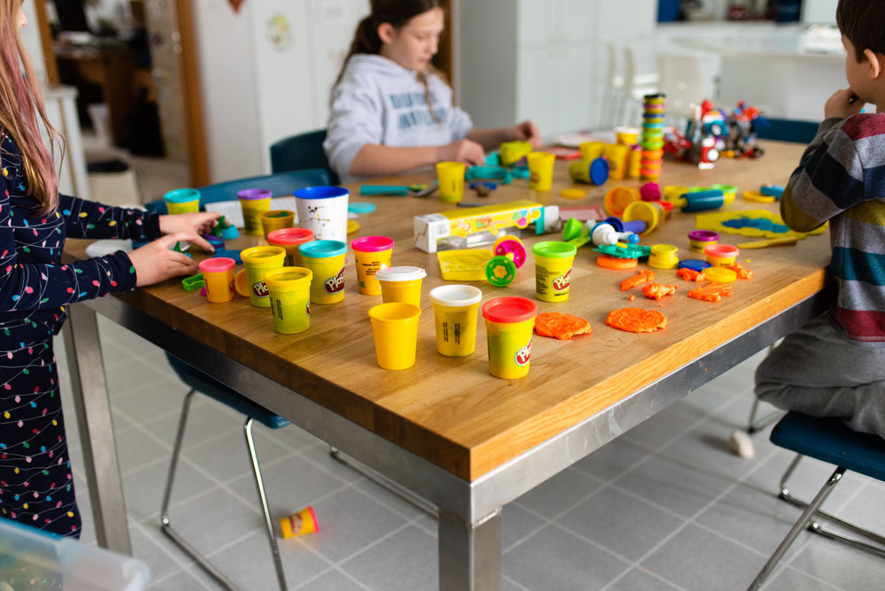 children playing with play-doh at a table.jpg