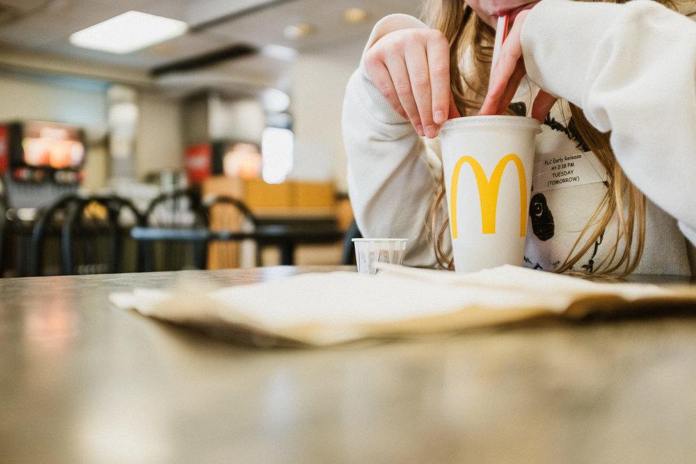girl drinking a soft drink at McDonald's in Lincoln Nebraska.jpg