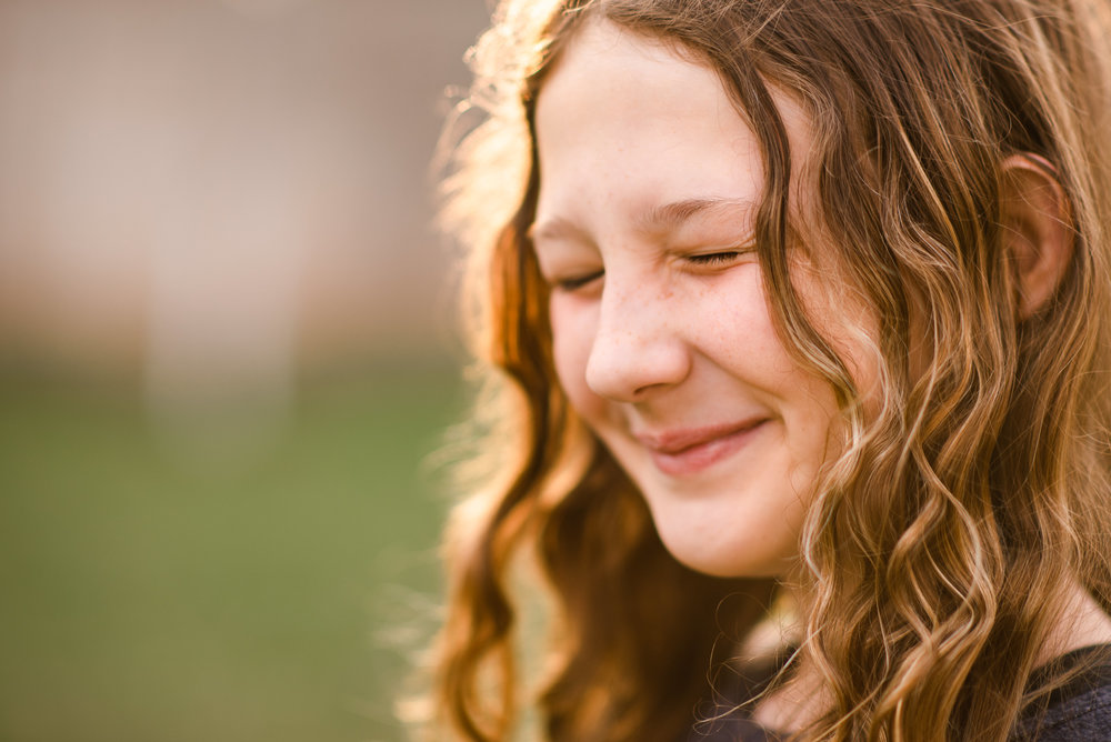 tween girl with curly hair squinting_.jpg
