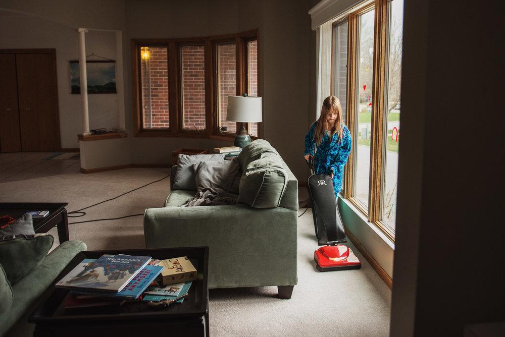 little girl vacuuming a living room_.jpg