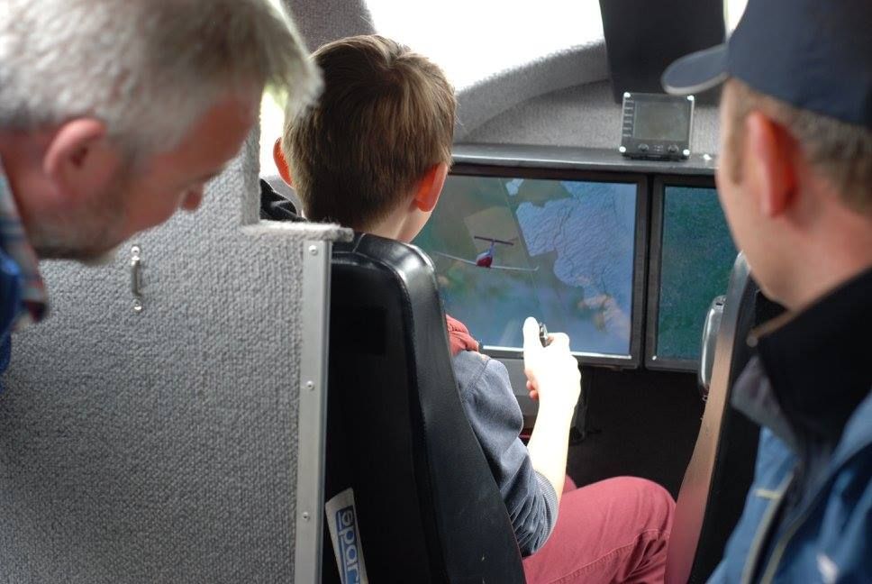 An eager trainee pilot tests his skills flying a rescue mission in the simulator