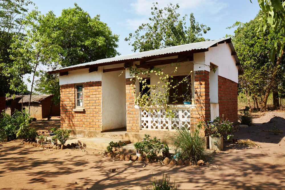 Individual traditional homes for orphans.
