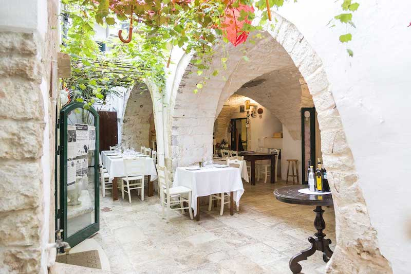 Cibus, nestled in the former warehouse of a 15th century monastery. Add it to your Puglia wishlist!