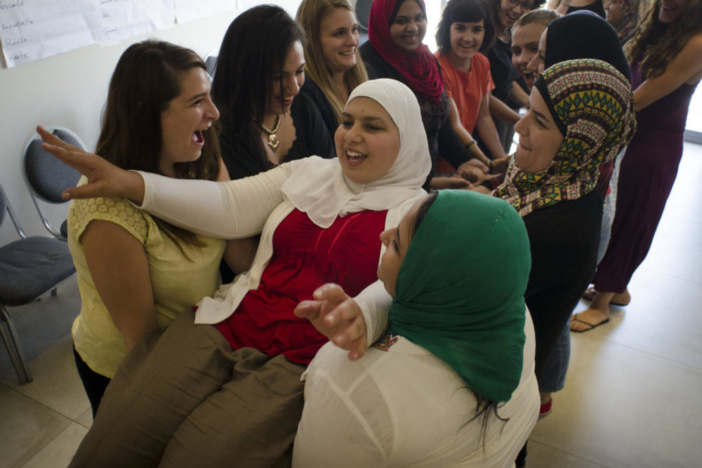 Young media makers from MENA and Europe engaged in a trust exercise. Photo: Annabella Stieren