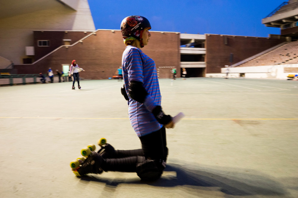 "Nouran El-Qabbany, 27, a graphic designer, demonstrates safety measures to new players. ""If you must fall, and you will fall, you should try to fall to the front not the back,"" she says. Photo: Marwa Sameer Morgan"