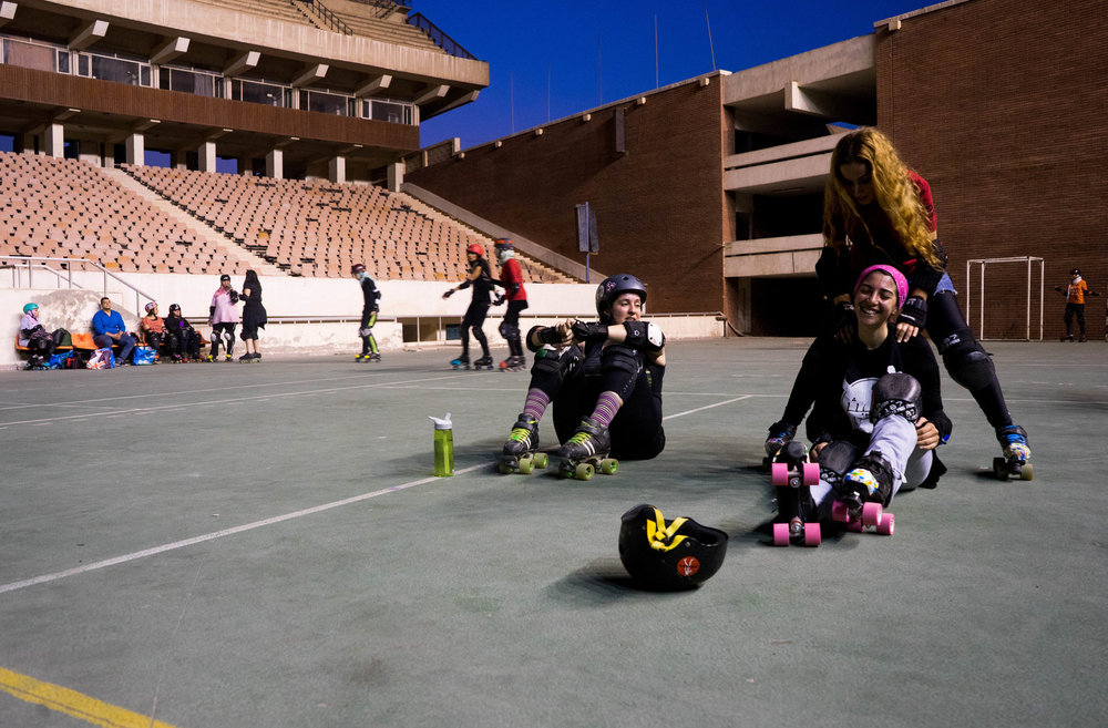 Sumer Abdelnasser (lower right) laughs at Nermine Abi Aad's joke during a practice break. Photo: Marwa Sameer Morgan