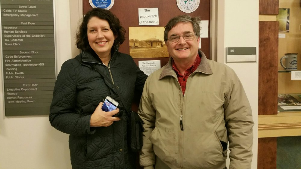 Cara Barlow (l), Director of the Derry Public Library, and Robert W. Crawford (r), Poet Laureate of Derry at the Derry Municipal Building