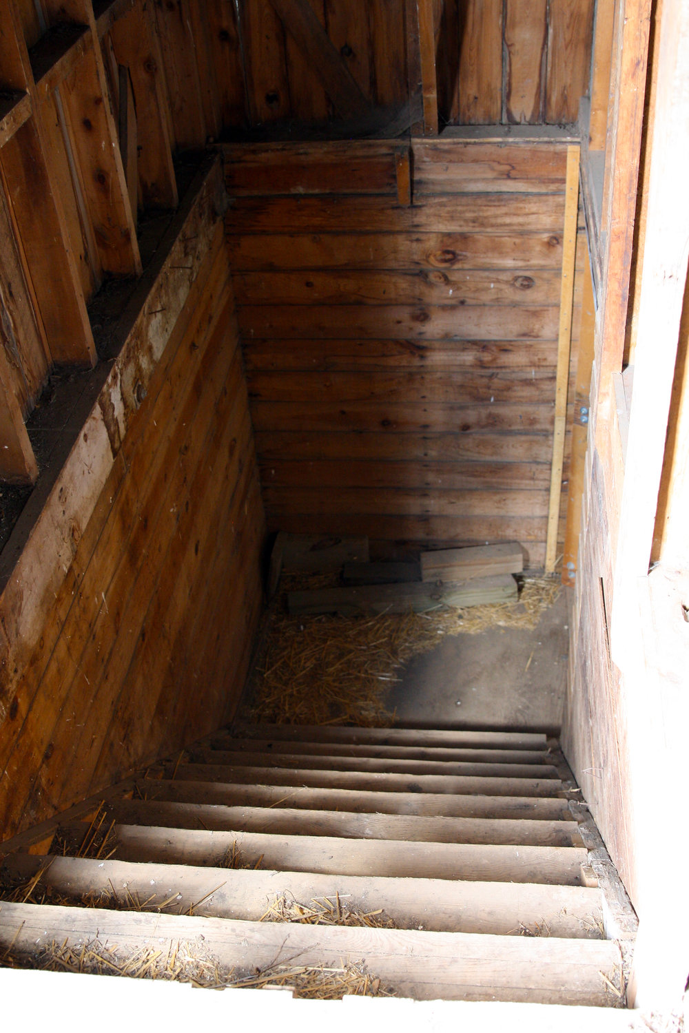 Looking down the narrow staircase in the barn.