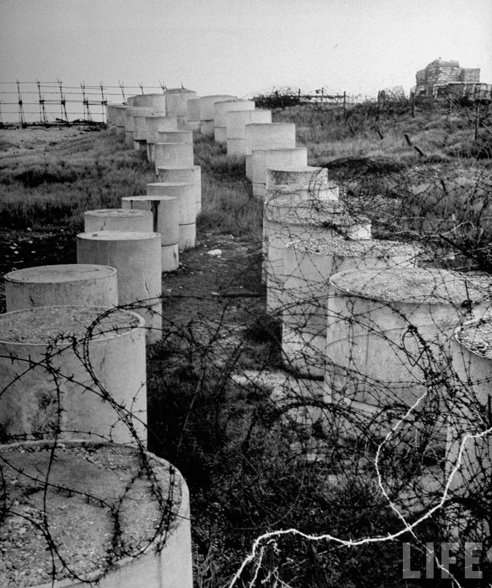 Cement anti-tank barrier shrouded with barbed wire. Eliot Elisofon, 1945 from LIFE magazine © Time, Inc.