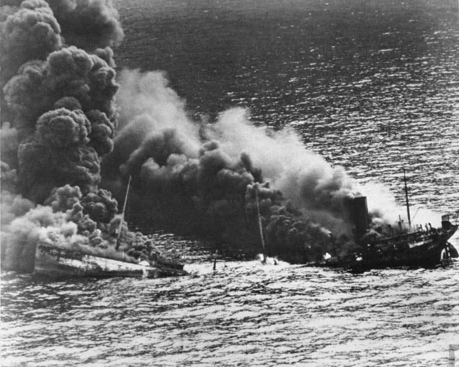 A tanker belches smoke as it sinks into the Atlantic after being hit by a German torpedo, 1942. from LIFE magazine © Time, Inc.