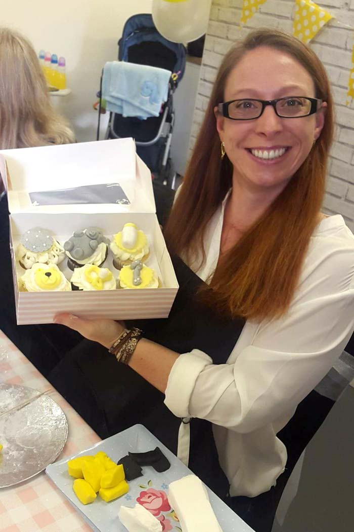 A very happy box of cupcakes, made at a Fondant Fleur class.