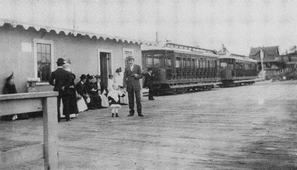 A wonderful view of the waiting room at the Bristol Ferry wharf with two open car trolleys waiting. Bristol Ferry train depot is in the background at right.