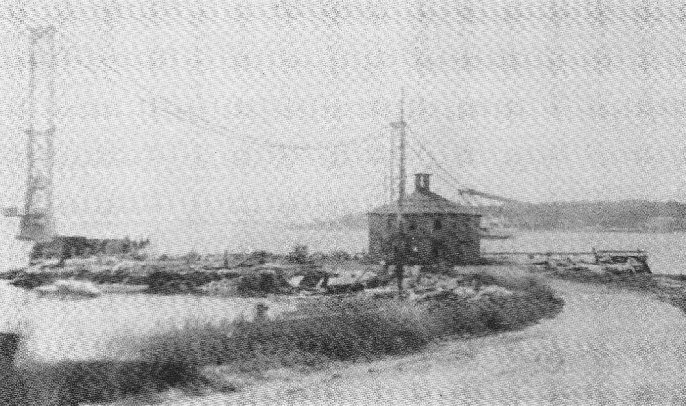 The wharf at Bristol Ferry while the Mt. Hope Bridge was under construction. Note the ferry behind the building.