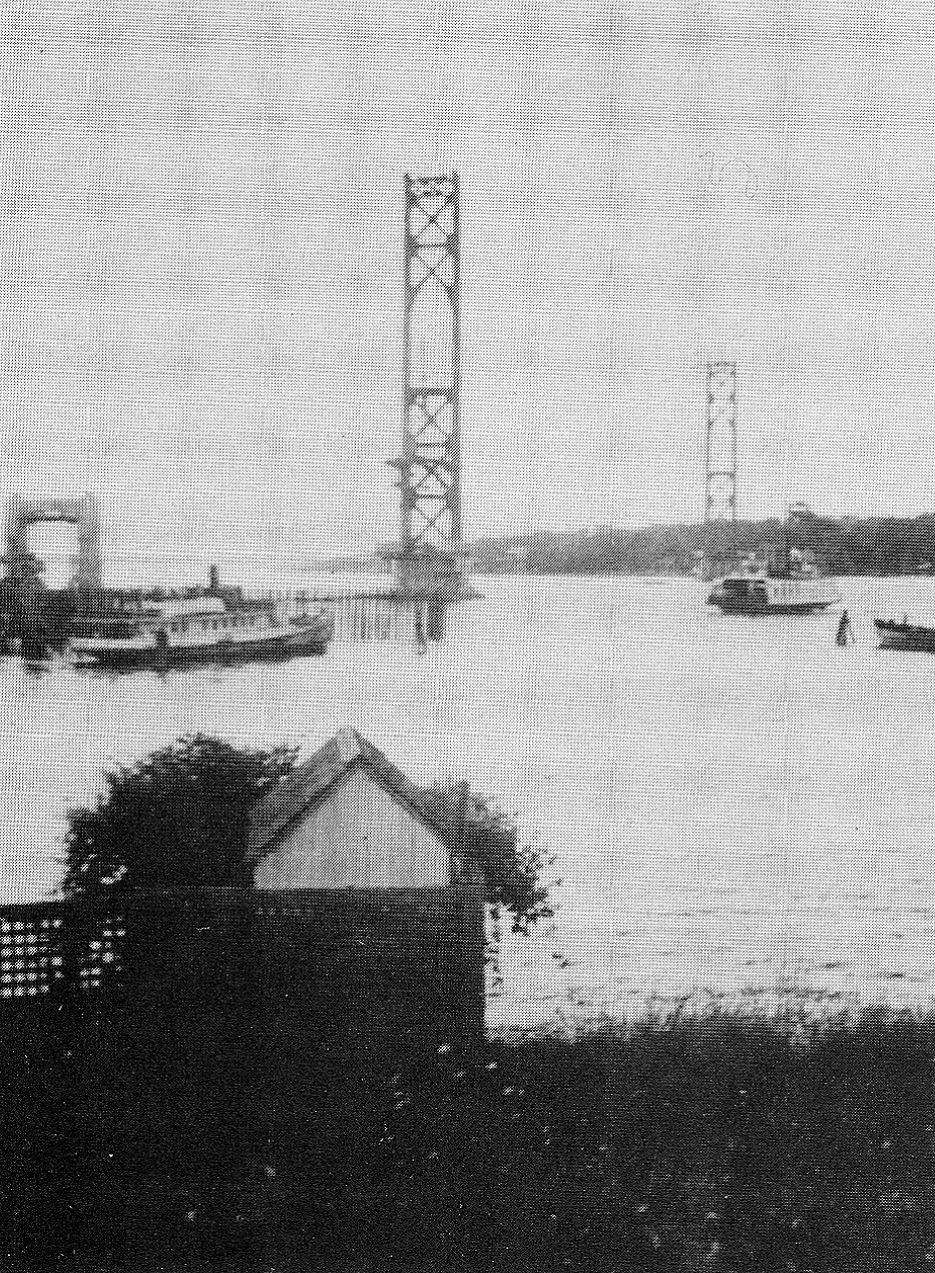 The ferries continue to cross as the bridge, which will eventually put them out of business, rises in the background.
