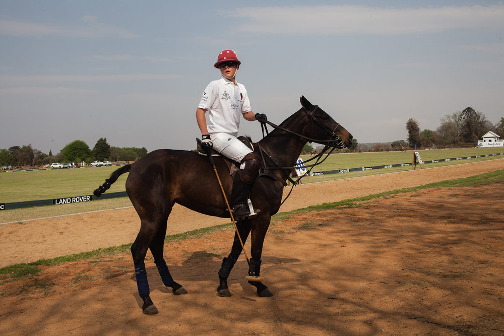 Chris, 16, about to play a polo in Inanda club, Sandton. 2014 .jpg
