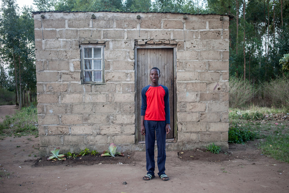 Young boy pose outside his house in KwaZulu Natal.2014.jpg