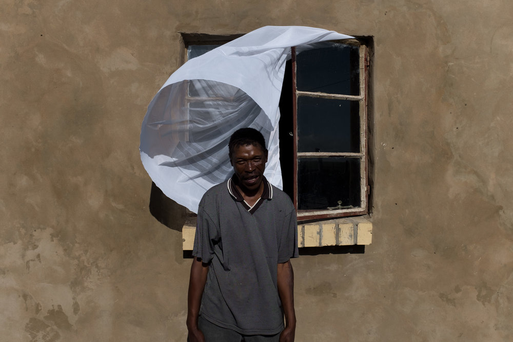 Nqamakwe  Portrait of Sipho's uncle outside their family house.  Format: Hahnemuhle Photo Rag Size: 11.69 x 16.53 inches (A3) Signed, Edition of 20 Price increases as Edition sells R1800 (approx. $130)