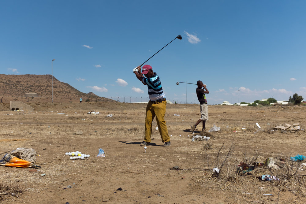 Botchabelo  At the driving range.  Format: Hahnemuhle Photo Rag Size: 11.69 x 16.53 inches (A3) Signed, Edition 2 of 20 Price increases as Edition sells R2200 (approx. $163)