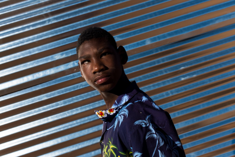 Upington  A boy affected by foetal alcohol syndrome.  Format: Hahnemuhle Photo Rag Size: 11.69 x 16.53 inches (A3) Signed, Edition of 20 Price increases as Edition sells R1800 (approx. $130)