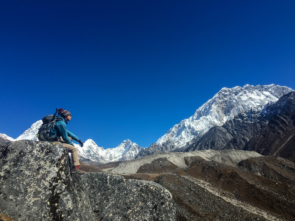 The higher peaks on the right are a cluster of mountains, including Lhotse (8,414m), Nuptse (7,861m), and Everest (8,848m)