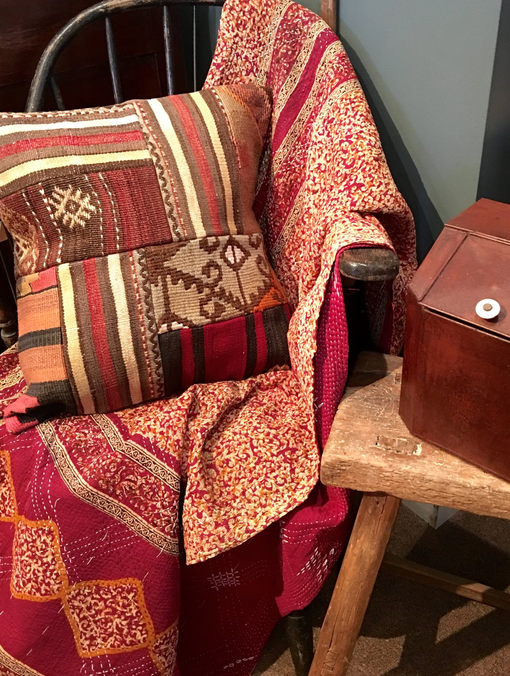 Colorful Kanthas and Kilim covered cushions brighten up any room!