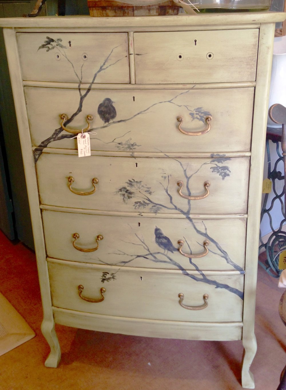 Julie's artistry is applied to an early 1900's chest of drawers. This piece sold in 20 minutes!