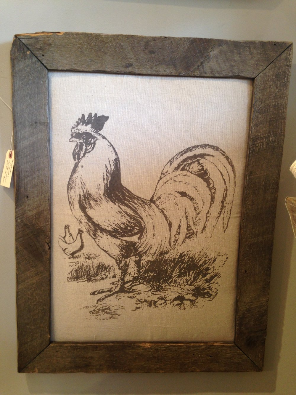The rooster is completely at home in his barnwood frame