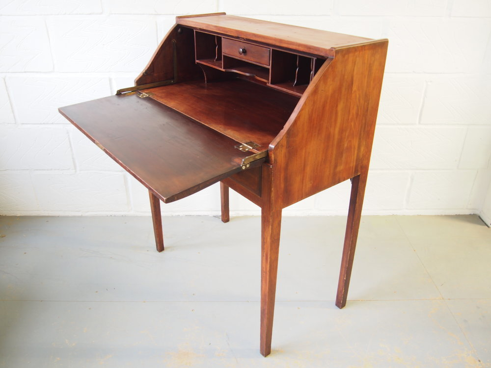 The Cherry wood writing desk has been treasured piece of the clients for many years.  The piece had not been unusable of a long period of time. Until the client approached me to fully restored it back to a functional and aesthetically pleasing state, to be once again loved and placed in the living room where it can be used and looked at every day.