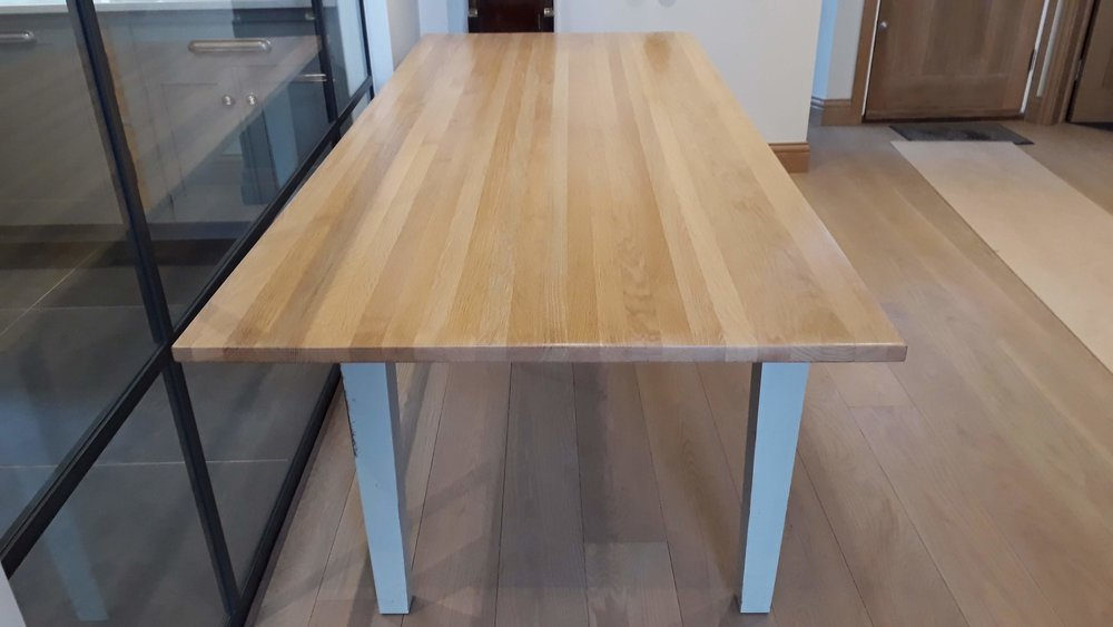 The Modern Oak Dining table was finished with a clear protective finish to bring out the natural beauty of the wood's appearance. A clear wax was then applied to further protect the surface of the table.