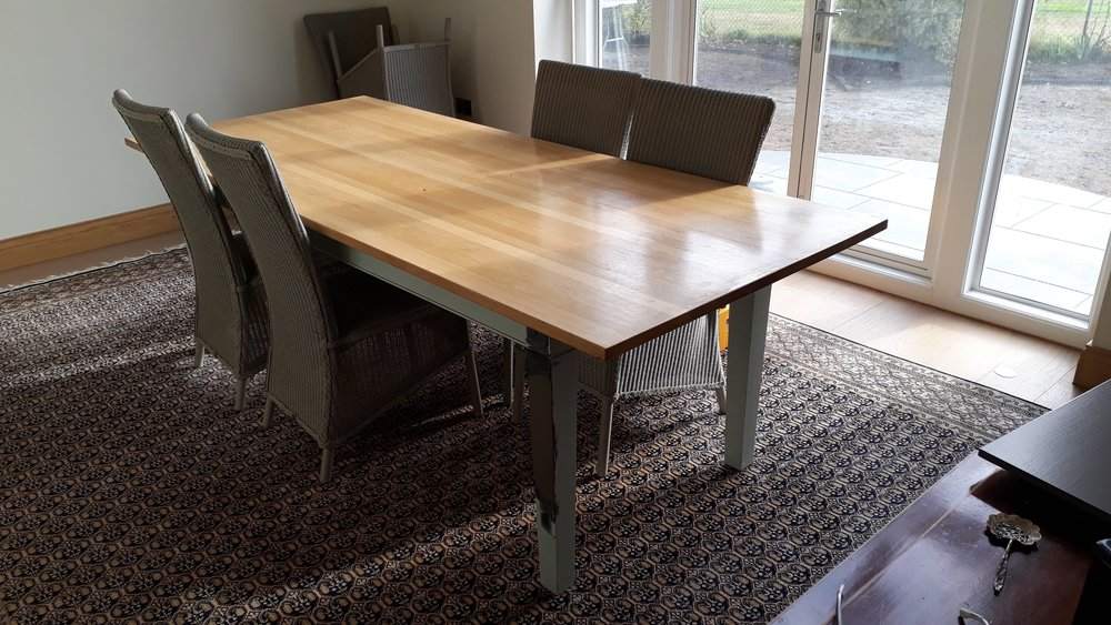 The Modern Oak Dining Table had been bleached to a orange and yellow apperance due to the sun's natural uv rays. The table required removing the surface finish and also to remove the surface scratches.